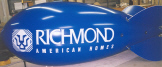 blue color advertising blimp with logo